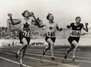 ca. 1928, Amsterdam, Netherlands --- Original caption: The finish of the eight heat of the 100-meter dash for women won by Myrtle Cook (left) of Canada; second place taken by Miss Wilson of New Zealand (right) and third by Miss Horst of Holland (center). --- Image by © Underwood & Underwood/Corbis